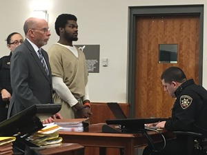 Naesean Howard, right, with his attorney, Ralph Cognetti, Friday morning in Syracuse City Court. Howard pleaded guilty to an April 2016 stabbing incident.