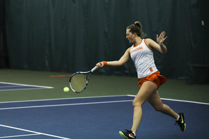 Gabriela Knutson smacks a forehand in recent game action. The SU sophomore beat the No. 14-ranked singles player on Sunday afternoon in a Syracuse win.